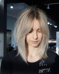 Shaggy Curtain Banged Lob with Undone Straight Texture and Platinum Blonde Color Medium Length Hairstyle
