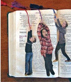 Photo Bookmarks  1) have subject pretend to climb a rope  2) cut out picture  3) laminate or coat w/ clear contact paper  4) use pin or small hole puncher to make a hole near the top, but not right on the edge  5) thread tassle thru hole and tie a knot  6) place in favorite book to mark place :)  *excellent Father's Day, Mother's Day, Birthday, just-because present