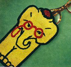 Professor Elephant Eye Glass Case crochet patterns from Crochet Gifts & Bazaar Novelties, originally published by the DMC Corporation, Volume 405, in 1953.