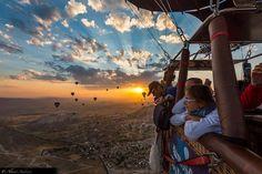 A hot air balloon over Cappadocia. Cappadocia is a historical region in Central Anatolia, largely in Nevşehir Province, Turkey.