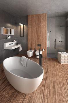 De vloertegels in houtlook, het losstaande ovalen bad, de zwarte kranen en betonlook tegels geven de badkamer een luxe en robuuste uitstraling. Hier uitgevoerd met wandcloset, bidet en inloopdouche. #houtlook #tegels #bad #ovaal #betonlook #bidet #wandcloset #luxe #wandtegel #inloopdouche