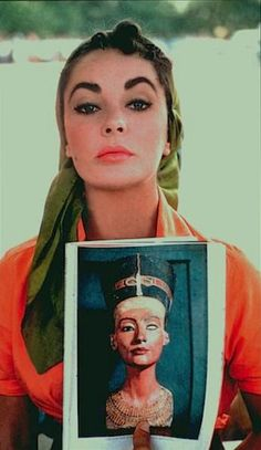 Elizabeth Taylor showing why she was picked to play cleopatra.  the similarity is striking.  the bust is cleo done while She was alive..