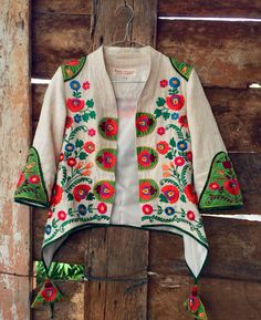 Batik Amarillis Made in Indonesia proudly presents :Batik Amarillis's Arcana jacket in Hungarian embroidery on natural, raw and beautiful Tenun gedog Tuban of Indonesia with tenun batik gedog Piping
