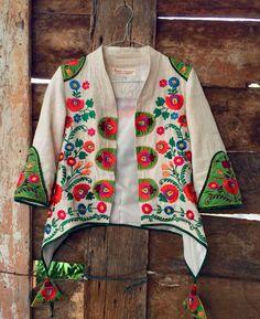 Batik Amarillis Made in Indonesia proudly presents :Batik Amarillis's Arcana jacket in Hungarian embroidery on natural, raw and beautiful Tenun gedog Tuban of Indonesia with tenun batik gedog Piping