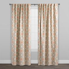 Our exclusive 100% cotton curtains feature our gray geometric tile design on a light-toned backdrop with pops of bright orange. These fully lined curtains boast a dual tab or sleeve-top option for versatile draping, adding a nicely tailored look to any space.