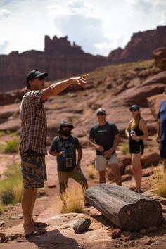 Guide Brinn shows guests petrified wood on a hike on their Cataract Canyon trip through Canyonlands National Park. Canyonlands National Park, Colorado River, Petrified Wood, Rafting, Idaho, National Parks, Hiking, Journey, Couple Photos