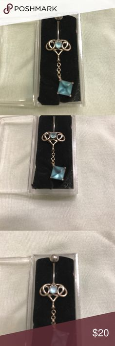 Aquamarine dangle body jewelry The detail caught my eye and was an impulse purchase that closely matched the other jewelry set listed. 2 aquamarine stone - one round one diamond cut. Purchased in Qatar.  Never worn but recommend cleaning prior to wearing Jewelry