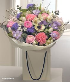 Sweetly Scented - A fantastically fragrant aqua pack gift bag bouquet in delicate springtime pastel shades. Pink Hyacinth, Carnations and Ranunculus are married with white Alstromeria, Ageratum, Anemone and Tulips. Lavender Freesias complete the arrangement.