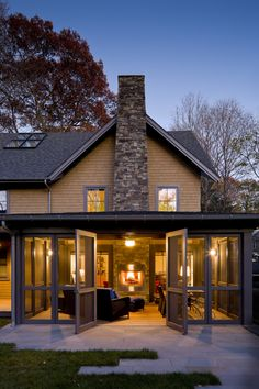 A family with a disabled daughter and a strong commitment to sustainable living engaged LDa to design a new home in their suburban Boston neighborhood. The couple desired a bright, open home that would be highly resource-efficient and intimately connected to the landscape and neighborhood, while giving their daughter the freedom to move independently throughout the main indoor and outdoor living spaces.