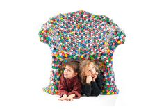 Bottle Caps: This colorful chair is constructed of recycled soda tops. Photo: inhabitat.com