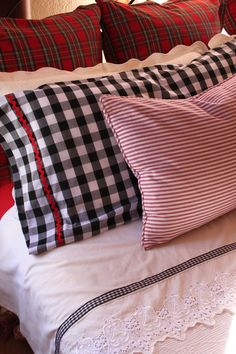 plaid duvet & pillow cases, homemade pillow cases, ribbon sewn on sheets - also with red toile draperies and metelesse bedspread