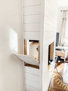 Step by step tutorial on how to build an inexpensive shiplap fireplace using an electric insert. Transform your boring TV wall into a statement piece. Diy Fireplace Mantel, Tv Above Fireplace, Build A Fireplace, Basement Fireplace, Shiplap Fireplace, Fireplace Built Ins, Fireplace Remodel, Living Room With Fireplace, Fireplace Surrounds