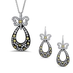 STERLING SILVER BONDED WITH PLATINUM WITH SIMULATED DIAMONDS BY SWAROVSKI FASHION SET.