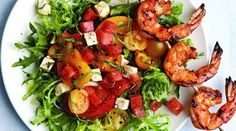 Appetizing salad with shrimps and tomatoes for Christmas
