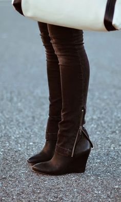 Perfect any fall look with our buttery-soft-leather wedge bootie