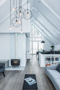 Minimal interiors draw focus to the snowy forest surroundings inside this family home in rural Lithuania