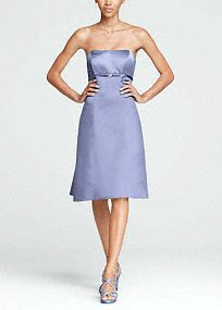 Traditional elegance meets modern decadence in this sensational satin dress reminiscent of Old Hollywood glam !   Strapless satin bodice features sparkling brooch and empire waist that helps create a stunning silhouette.  Pleated and tie back detail adds dimension and finishes off the look.  Fully lined. Back zip. Imported polyester. Dry clean.