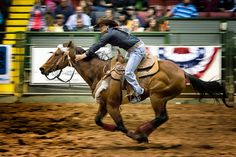 The Home Stretch; photograph by Duane Bender. Barrel Racing competition at the Ft. Worth Stockyards Rodeo