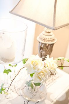 White roses with stylish candle holders