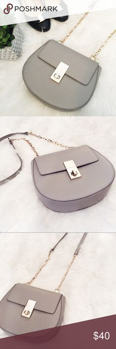 """Express Gray/Taupe Purse with Gold Chain Strap Like new - great condition! Only used once. Taupe colored purse with gold chain shoulder strap, super comfortable to use and very versatile! Size - length across top of purse: 8"""", vertical length of just the purse: 7"""", & it is about 3"""" wide! Length of purse and chain: 26"""", length of chain: ~19"""". Express Bags Shoulder Bags"""