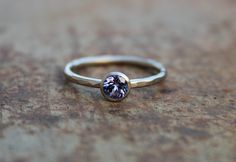 Sleek, beautiful ring made of 14k whitegold (with palladium) with a sparkling tanzanite. The combination of the slightly dark whitegold and the intense violette gemstone is enchanting; a real eyecatcher!  The bezel is made conical, the wire is a little forged.