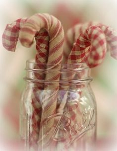 Crumple up tin foil, shape it into a candy cane, wrap in prim fabric.