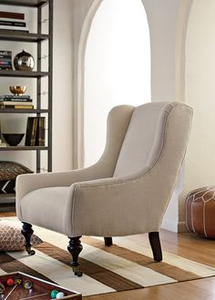 The low and deep seat on this classic chair shape (starting at $1,150) provides comfort without skimping on style. Lowell Wingback Chair.
