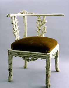 Syrie Maughm faux bois corner chair, later Bunny Mellon's, then Bruce Budds. Fantastic, formal whimsy.