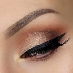 gold shimmery smokey eye with winged liner ~  we ❤ this! moncheribridals.com