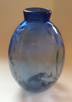 Large blue vase designed by A.D. Copier for Leerdam in 1942. The vase has an optical effect.  The vase is 31.8 cm in height and 21 cm in diameter. It is marked with CL etched on the underside.