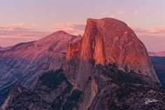 Half dome light  This is the view one can enjoy from Glacier Point, in the Yosemite National Park. The world famous Half Dome is colored of warm and fantastic tones, and the whole park becomes pink just before the blue hour. Doesn't worth a long long travel from home to watch a similar show?For prints or licenses visit my  shop