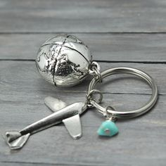 If you've been searching the globe for the perfect airplane key chain, look no further. Your keys will never be happier. This handmade, and hand soldered airplane key chain is a perfect reminder to bu