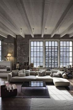 Brick, windows, beams, couch and color palate....Like the rug placement too! Beautiful :)