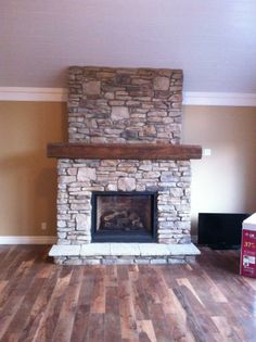 Cultured stone fireplace done by Tika Tile & Marble
