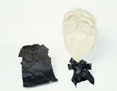"""1780-90 Men's wig and wig bag. Wig made from bleached horse hair mane. The hair comprises of loops which are braided into """"strings"""" or cords which run in parallel rows of which are attached to a fine diamond-pane silk sheet. The lining comprises another layer of coarser silk net. Belonged to Thomas Carill-Worsley, who lived at Platt Hall. Gallery of Costume, Manchester."""