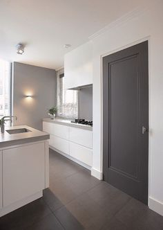 White cabinets, grey stone top and grey tiles