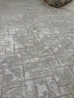 """Erin Gates: """"So we're planning on installing one in the next month and have decided on stamped concrete for a few reasons- 1) budget 2) ease of maintenance. And while concrete doesn't sound very natural and pretty- think again. This is a stamped concrete walkway that my dad's firm installed at a project recently….."""""""