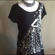 Kenneth Cole Reaction Silver Foil Graphic Shirt Good condition. Gently worn. Always got compliments when I wore it. Foil graphic is a little worn under the arm. Not noticeable when wearing, although I will still accept offers accordingly. Kenneth Cole Reaction Tops Tees - Short Sleeve