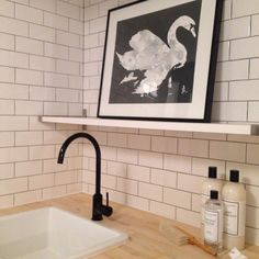 Laundry room - ikea black faucet.  Bijou and Boheme