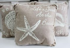 "Set of 3, 10"" decorative nautical pillows in beige and white tones for your couch, bed or patio. Each pillow comes with a seashell and a saying."
