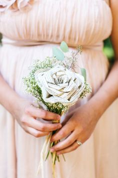 Bridesmaids bouquets made from paper (book pages) roses  *I actually really like this!  @Tiff Blais  Thoughts?  @Beth Sharp @Natasha Frenzo @Brooke Fritz