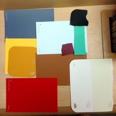 Using paint swatches to mock up the colors of design objects in a room