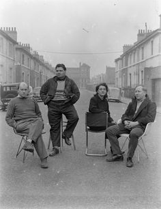 Photographer Unknown 'Photograph showing Nigel Henderson, Eduardo Paolozzi, Alice and Peter Smithson, seated in an unidentified street', [c.1949–c.1956] ©  Nigel Henderson Estate