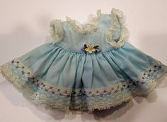 """I am not sure what doll this dress went with. Size: 4-1/4"""" Shoulder to hem. 4"""" across waist. 3-1/2"""" across shoulder. I think it would fit a 9-11"""" baby or toddler type doll. Condition: No tears or repairs, some very tiny dark spots hidden in folds. 