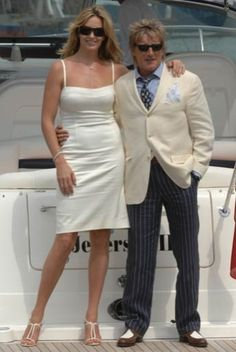 Rod Stewart and Penny Lancaster tied the knot in 2007 in an informal ceremony just outside Portofino, Italy. Penny looked beautiful in a simple white gown and strappy heels.