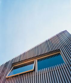 A cedar-slat rain screen hangs on the facade of Denis Carpenter's concrete house in Jersey City, softening its appearance and adding a mo...