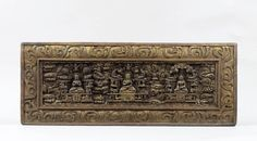 Manuscript cover with Prajnaparamita (centre), Vairochana (left) and Shakyamuni (right), Tibet, 14th century, Carved wood with traces of pigment and gilding, 29 x 73.5 x 3.2 cm (11 ½ x 29 x 1 ¼ in)