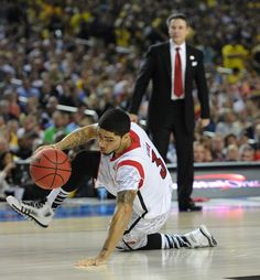JOHNNY CRAWFORD / JCRAWFORD@AJC. April 8, 2013 - Atlanta: Louisvilles Peyton Siva keeps his dribble alive after falling to the floor during 2013 NCAA Division 1 Mens National Championship game inside the Georgia Dome in Atlanta on Monday, April 8, 2013. JOHNNY CRAWFORD / JCRAWFORD@AJC.COM