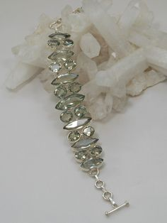 "Handmade matching oval and marquis-cut Green Amethyst gemstones adorn this bracelet,beautifully bezel-set in 925-hallmarked sterling silver. Length: 6-8.5""+ Adjustable toggle clasp. Widest center dime"