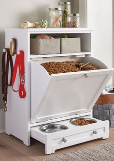 Enjoy the convenience of food leash and toy storage plus a feeding station all in one stylish compact space with our Pet Feeder Genius Solutions for Your Pets in the Kitchen Animal bones and scrap meat or fat may be used to make an extreme Diy Casa, Dog Rooms, Pet Feeder, Dog Houses, Home Organization, Organizing, Pantry Organisation, Diy Furniture, Dog Crate Furniture
